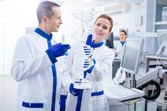 Budding meditative scientists team using DNA model Stock Photography