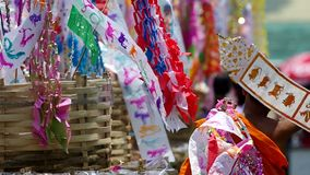Buddish novice and Tung Lanna Flags on Songkran day. Chiang Mai, Thailand - APRIL 13, 2015: novice carried Tung Lanna Flags around the sand pile in the temple in stock video footage