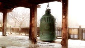 Buddist Bell Snowfall stock video footage