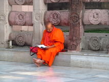 A buddist monk in orange traditional dress Royalty Free Stock Photos
