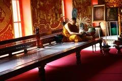 Buddist monk reading magazine Stock Image