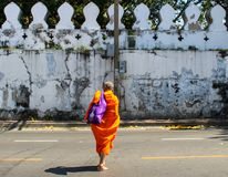 Buddist monk walking at the street royalty free stock photo