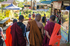 Buddist monks talking during walk Stock Photos