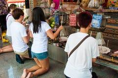 Buddist religious people praying at the temple from Damnoen Saduak Floating Market, Thailand Stock Images