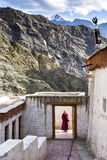 A Buddisth monk wait for visitors at the entrance of Rizong Monastery in Ladakh region Royalty Free Stock Photo