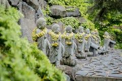 Buddistisk sten i templet Arkivfoton