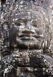 Buddistisk stenframsida i den Bayon templet Angkor Thom royaltyfria foton