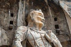 Buddistiska skulpturer i den Fengxiangsi grottan, Luoyang, Kina Royaltyfri Fotografi