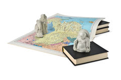 Buddistiska statyetter och en översikt av Kina Arkivbilder