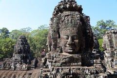 Buddla vänder mot Angkor Wat Royaltyfri Foto