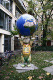 Buddy bear. CIRCA FEBRUARY 2009 - BERLIN: a Buddy Bear with a globe, Berlin-Mitte stock image