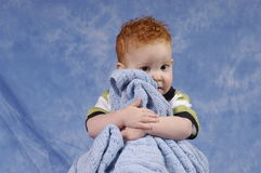 Buddy and his blanket. Redhaired boy holding his blanket tightly Stock Image