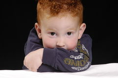 Buddy's eyes. Redheaded young boy close-up Stock Image