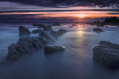 Bude, Cornwall, United Kingdom at sunset, beautiful seascape, se. A crashing against rocks Royalty Free Stock Photo