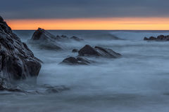 Bude, Cornwall, United Kingdom at sunset, beautiful seascape, se. A crashing against rocks Royalty Free Stock Images