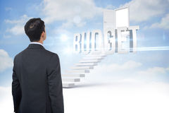 Budget against steps leading to open door in the sky Stock Photography