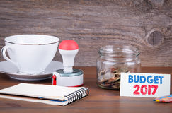 Budget 2017 - business, financial concept. Money in the glass on. A wooden table. texture background Royalty Free Stock Photo