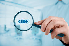 Budget. Businessman (accountant, financial manager) is focused on budget. Office in background stock photography
