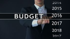 2018 budget, businessman selects file on virtual screen, annual financial report. Stock footage stock video footage
