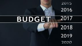 2019 budget, businessman selects file on virtual screen, annual financial report. Stock footage stock video