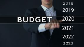 2022 budget, businessman selects file on virtual screen, annual financial report. Stock footage stock video footage