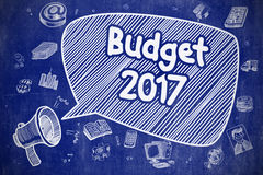 Budget 2017 - Cartoon Illustration on Blue Chalkboard. Budget 2017 on Speech Bubble. Doodle Illustration of Screaming Megaphone. Advertising Concept. Business Stock Image