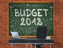 Budget 2018 on Chalkboard in the Office. 3d. Green Chalkboard with the Text Budget 2018 Hangs on the Red Brick Wall in the Interior of a Modern Office Stock Image