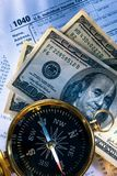 Budget, compass and money. Annual budget, compass, tax form and dollar Stock Image