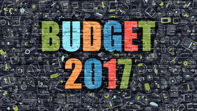 Budget 2017 Concept with Doodle Design Icons. Budget 2017. Multicolor Inscription on Dark Brick Wall with Doodle Icons. Budget 2017 Concept in Modern Style Royalty Free Stock Photography