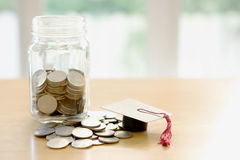 Budget concept. education money savings in a glass Stock Images