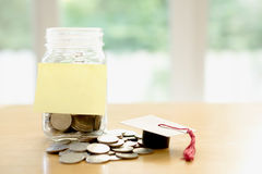 Budget concept. education money savings in a glass Royalty Free Stock Image