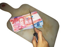 Budget cut. Philippine Peso bills and budget cuts royalty free stock images