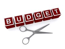 Budget cut. Red toy blocks with white lettering spelling budget next to silver scissors on white Royalty Free Stock Image