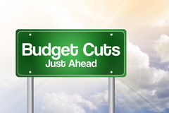 Budget Cuts Green Road Sign. Business concept Stock Photos