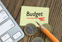 Budget with euro concept. Budget concept written on a note, with euro coins in background Stock Image