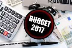 Budget exercise or forecast concept with old clock with black display Stock Photos