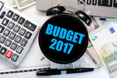 Budget exercise or forecast for the upcoming year 2017 with vintage clock with black display concept Stock Photos