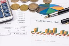 Budget and graph with euro coin. And calculator Stock Photos