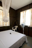 Budget guest house room with mosquito net Stock Photo