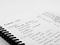 budget- handskrivet home fodrat anteckningsbokpapper Royaltyfri Foto