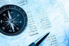 Budget, kompass och penna Arkivbild