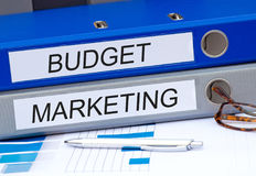 Budget and Marketing, two binders with text. On desk in the office royalty free stock photos