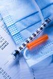 Budget, mask and syringe Stock Photos
