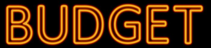 Budget neon sign. Abstract 3d rendered words budget orange neon sign on black background Royalty Free Stock Images