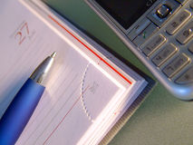 Budget Planning. Calculator, pen and day planner and communications Royalty Free Stock Photography