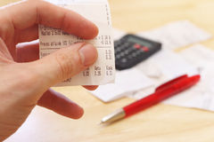 Budget planning. Cash check in the hand Royalty Free Stock Image