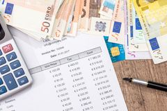 Budget, sale, monthly report, calculator and euro. Pen Royalty Free Stock Photo