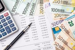 Budget, sale, monthly report, calculator and euro. Pen Royalty Free Stock Images
