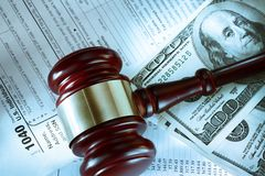 Budget, tax form, gavel and dollars Stock Photography