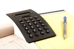 Budget Tools. Calculator, legal pad and receipt book Stock Photos